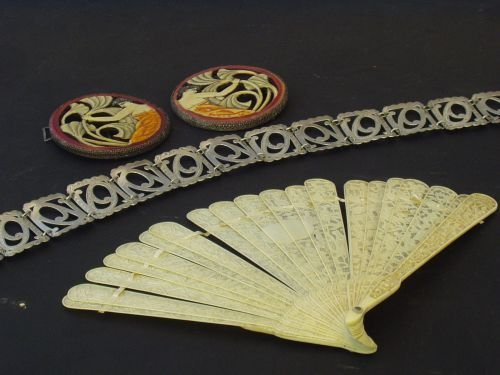19E: A pair of Art Deco bakelite belt buckles; bone glo