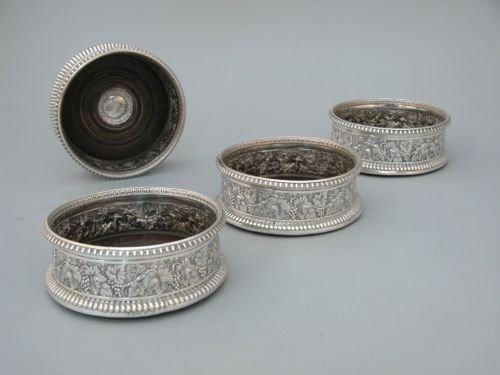 488E: A set of four George IV silver wine bottle coaste