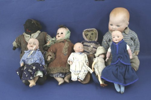 5: 6 various bisque-head dolls, and two soft toys