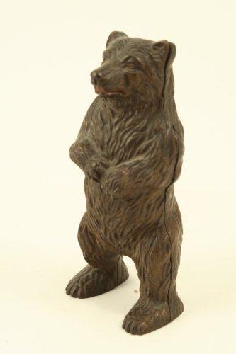 79: A late 19th century cast iron bear money box