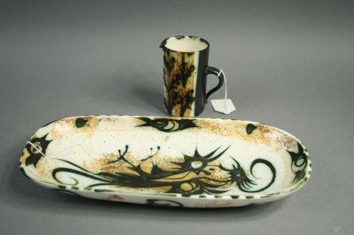 394: A Celtic Pottery, Newlyn jug and dish,