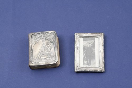 1338: A silver mounted miniature cookery book & photo f