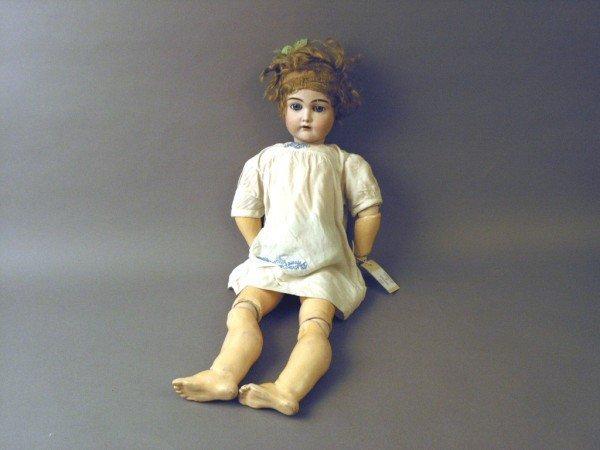 1: A German bisque doll