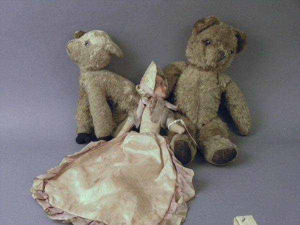 7: A gold plush Teddy bear, as viewed