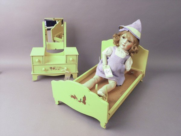 10: A Jumeau bisque doll, clothing and furnishings