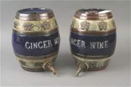 713 A pair of Royal Doulton glazed stoneware barrels