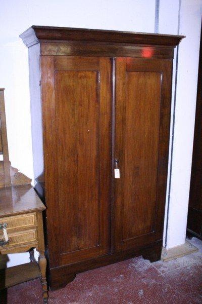 1010: *A Victorian mahogany two door cupboard, 3ft 8.5i