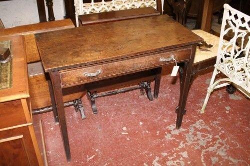 1011: *A George III mahogany side table, 3ft