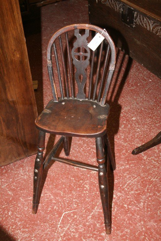 1013: An early 19th century child's wheelback high chai
