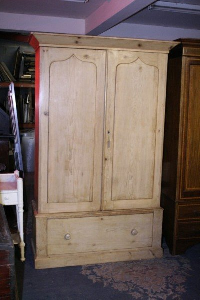 1016: A large pine wardrobe, 4ft 4ins