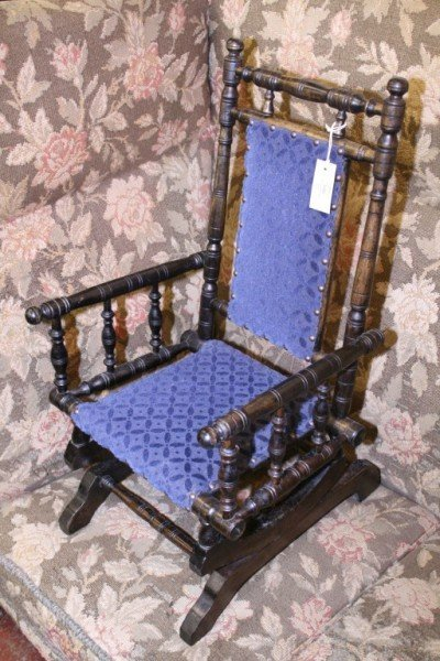 1022: *A late Victorian ebonised child's rocking chair