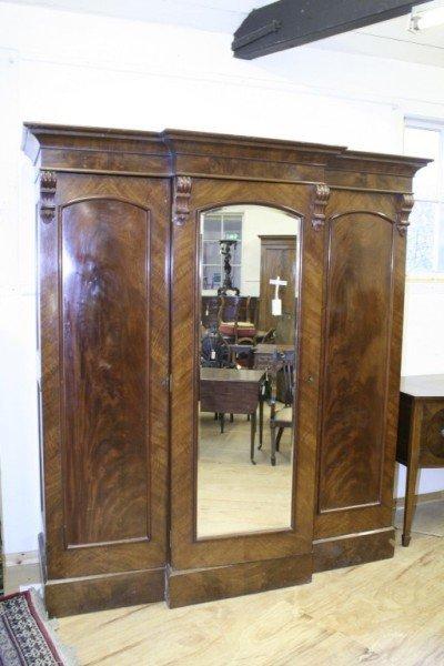 1023: *A large Victorian mahogany breakfront three door