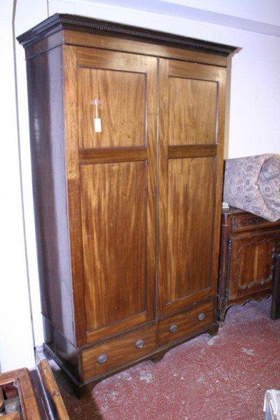 1024: *A George III style mahogany two door wardrobe