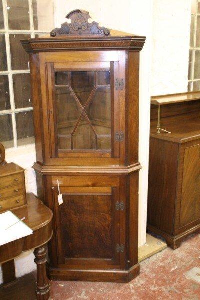 1026: *A walnut standing corner cupboard