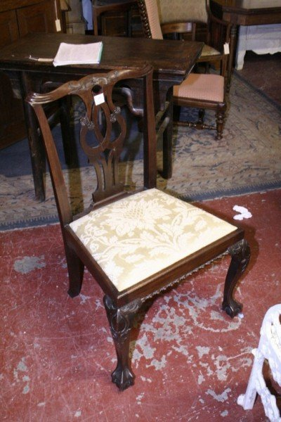 1027: A George III mahogany Chippendale design dining c