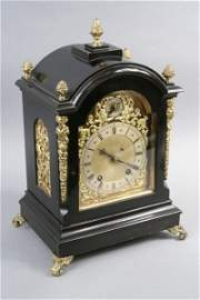 1196: *A late 19th century ebonised bracket clock in Ge