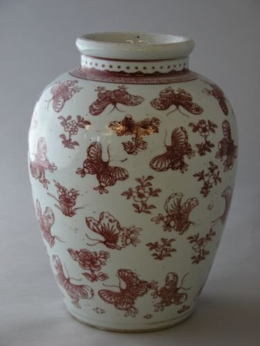 127E: A Chinese jar decorated with butterflies and foli