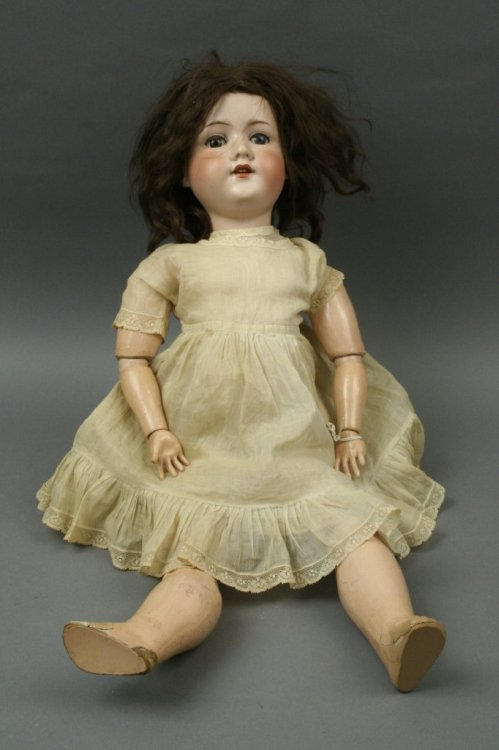 1: An Armand Marseille bisque doll, 24in.