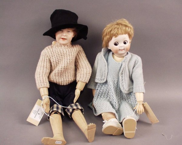 6: A modern bisque 'googly-eyed' doll, and 1other doll