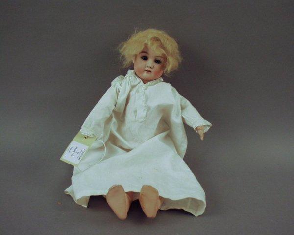 7: A Schoenau & Hoffmeister bisque doll, 17in.