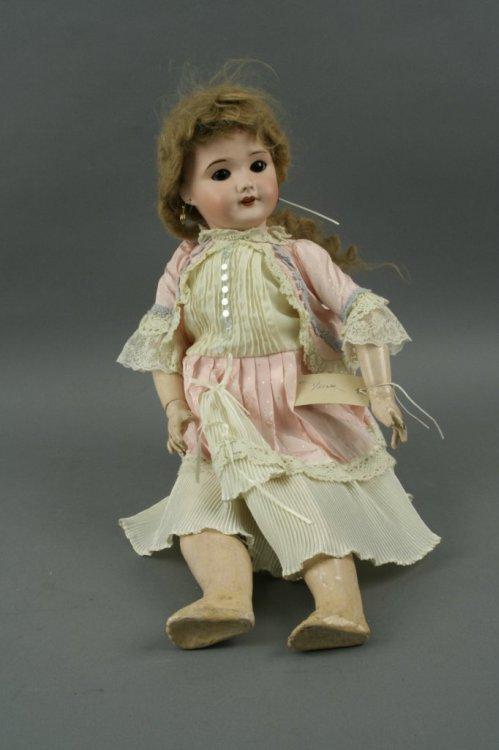 8: An SFBJ bisque doll, 22in.