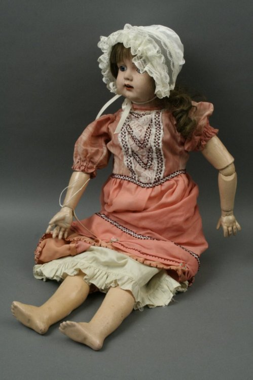 9: An English painted china doll 'Cecily', 28in.