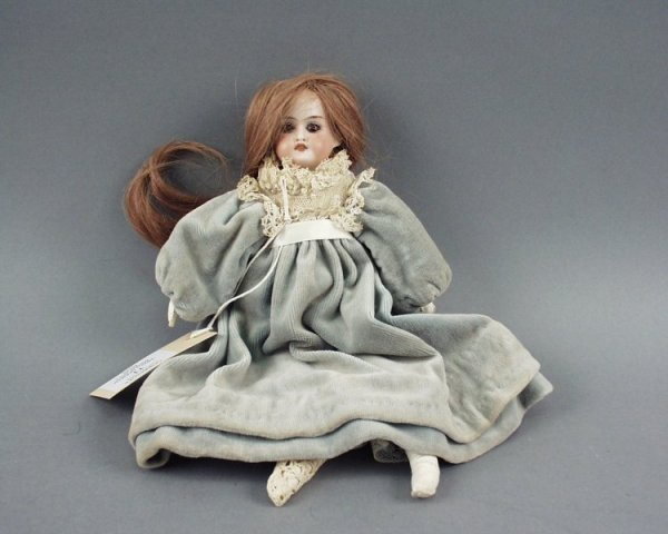 11: A small German bisque doll, 12in.