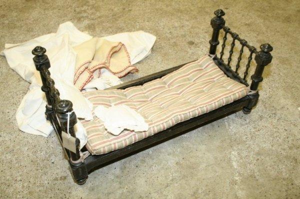 13: A Victorian dolls bedstead, 1ft 11ins x 9ins