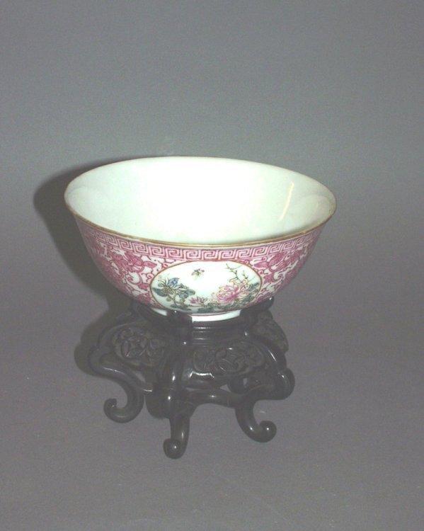 594: A Chinese famille rose porcelain bowl on hardwood