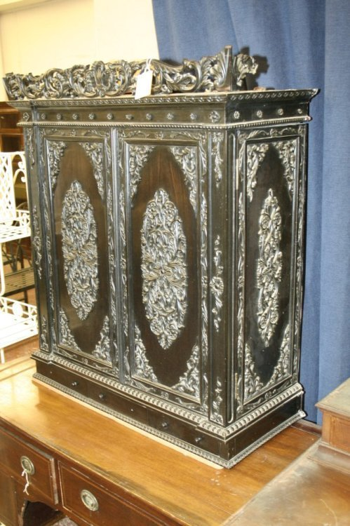 849: An Anglo-Indian carved ebony cabinet, 2ft 7ins