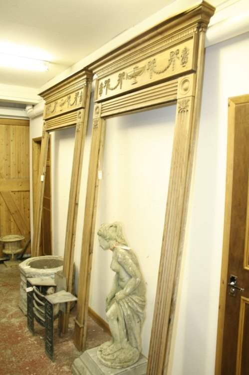 854: A Neo-classical design carved pine door surround,
