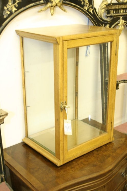 858: A small oak display cabinet, 1ft 4ins