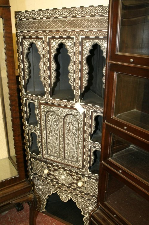 861: A Middle Eastern 'Damascus' inlaid corner cabinet,