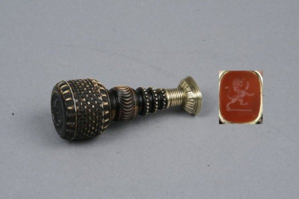 1583: A mid 19th century carved and stained ivory and g