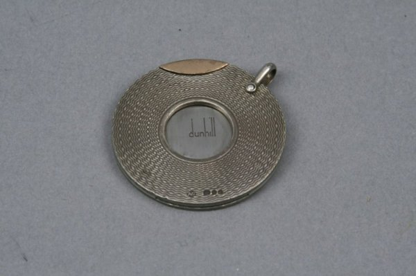 1598: A Dunhill silver and gold cigar cutter, 1.75ins