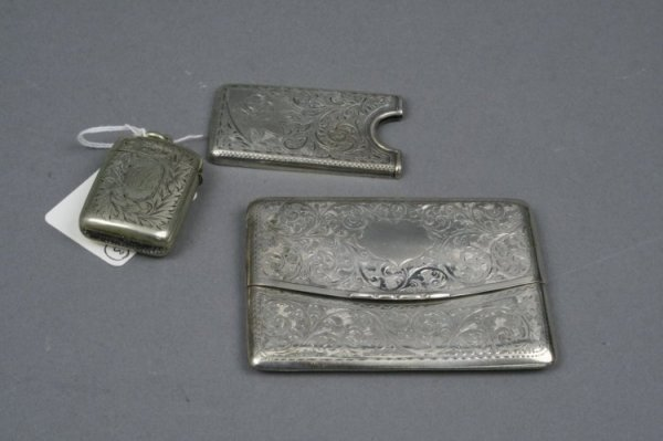 1603: An Edwardian silver calling card case, another ca