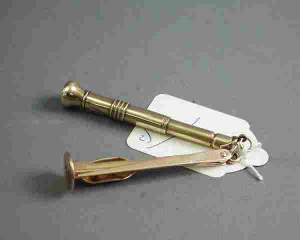 An Edwardian 9ct gold cigar piercer, 3 and 2.75in