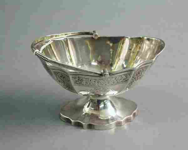 A Victorian provincial silver sugar basket, 5.25i
