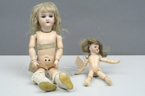 1: Two bisque dolls,