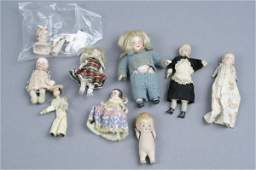 5: A googly-eyed doll and 13 other dolls