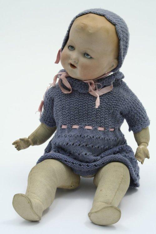 7A: An Armand Marseille bisque doll, 14ins
