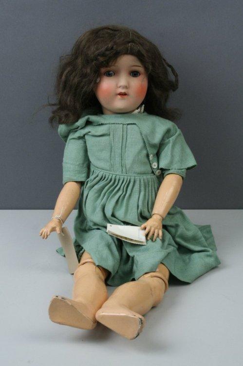 8: An Heinrich Handwerk painted bisque doll, 23in.