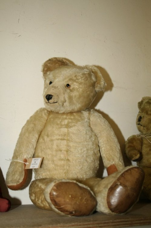 19: A large Chiltern Teddy bear, 30in. - pads replaced
