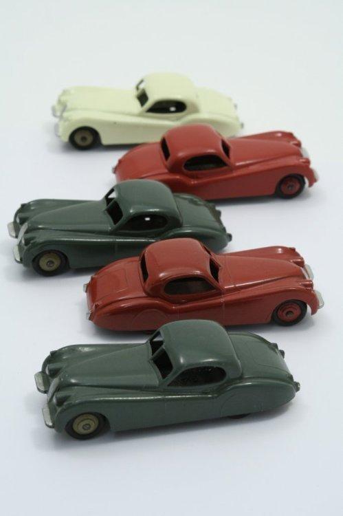21: Five Dinky Toys 157 Jaguar XK 120, near-excellent;