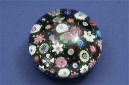 880: A mid-19th century French millefiore paperweight,