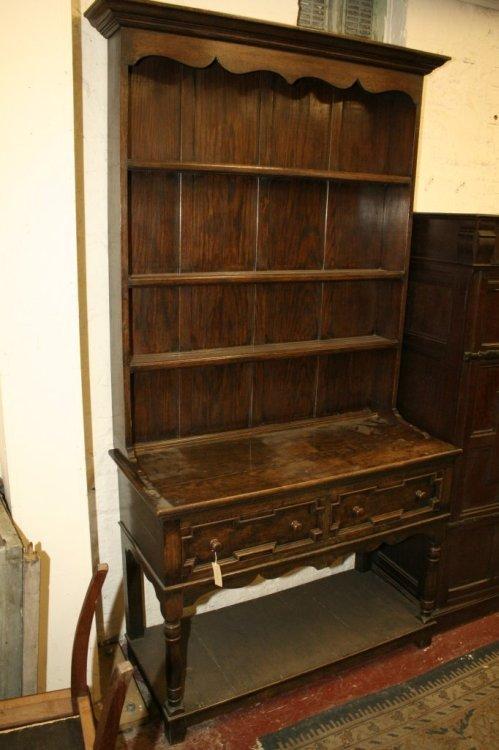 946: A 1920's Jacobean design oak dresser 3ft 9ins