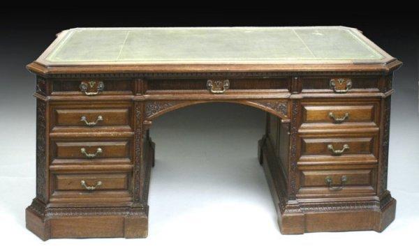 1106: A Victorian carved mahogany pedestal partners des