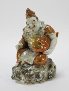 Japanese Kutani Porcelain Seated Immortal Figure