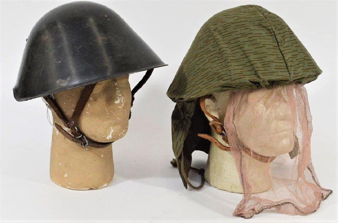 East German Steel Helmets one w/ Camouflage Cover