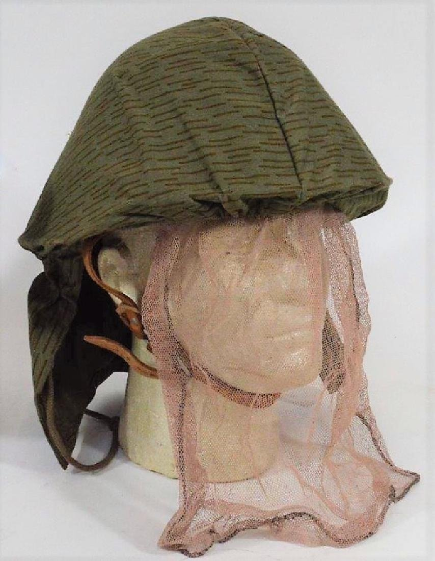East German Steel Helmets one w/ Camouflage Cover - 2